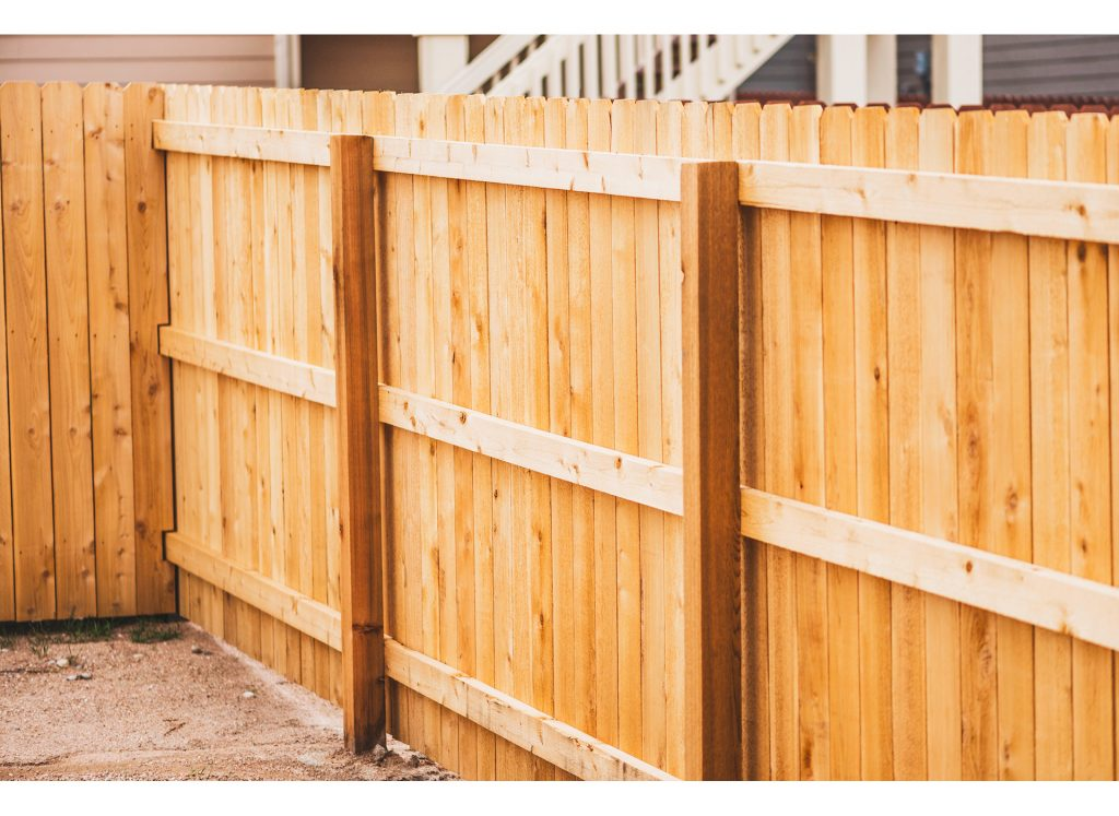Golden wood corner fence.